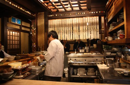 A chef prepares dishes at Mingeichaya, an izakaya restaurant in Kurashiki, Okayama.