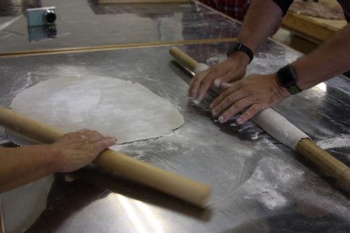 Rolling out the dough to make homemade soba noodles.