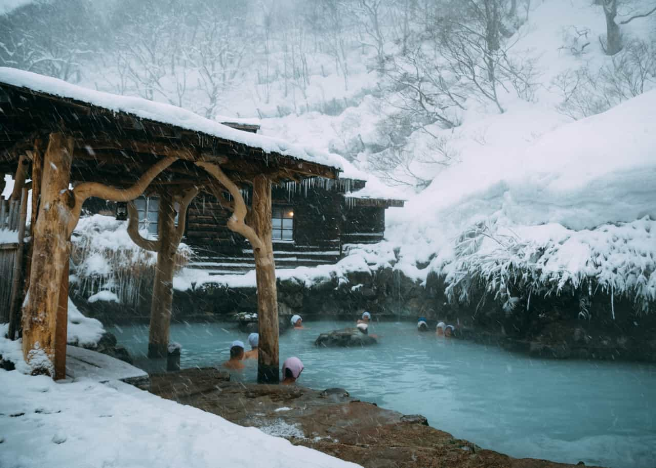 Bathers enjoy the onsen and snow at Tsurunoyu in Nyuto onsen, Akita, Tohoku, Japan.