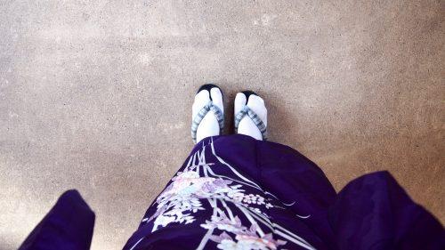 Wearing tabi socks and wooden geta.