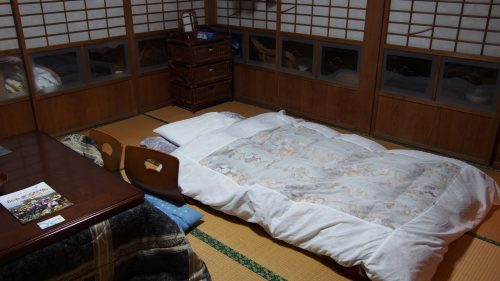 A traditional futon on the tatami floor.