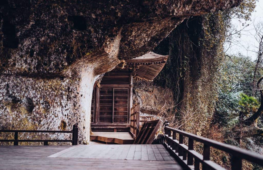 Japanese Buddhist temple in cliff in Japan