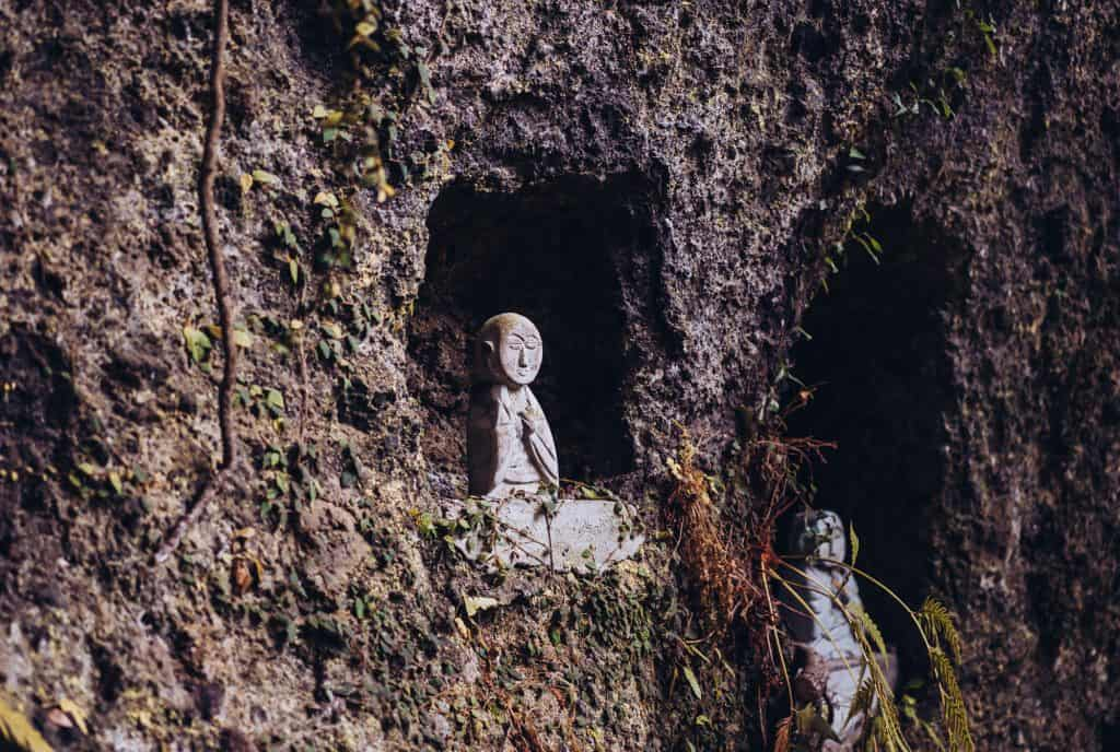 Japanese Buddhist statue in side of cliff in Oita prefecture