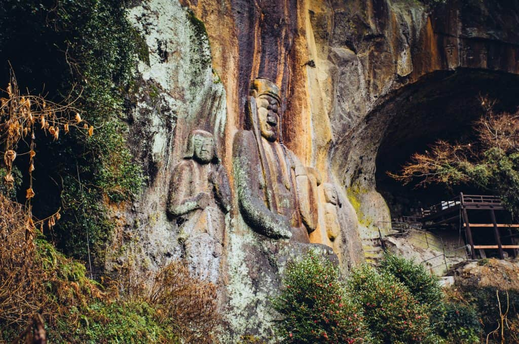 Japanese Buddhist statues carved into rock in Oita Japan