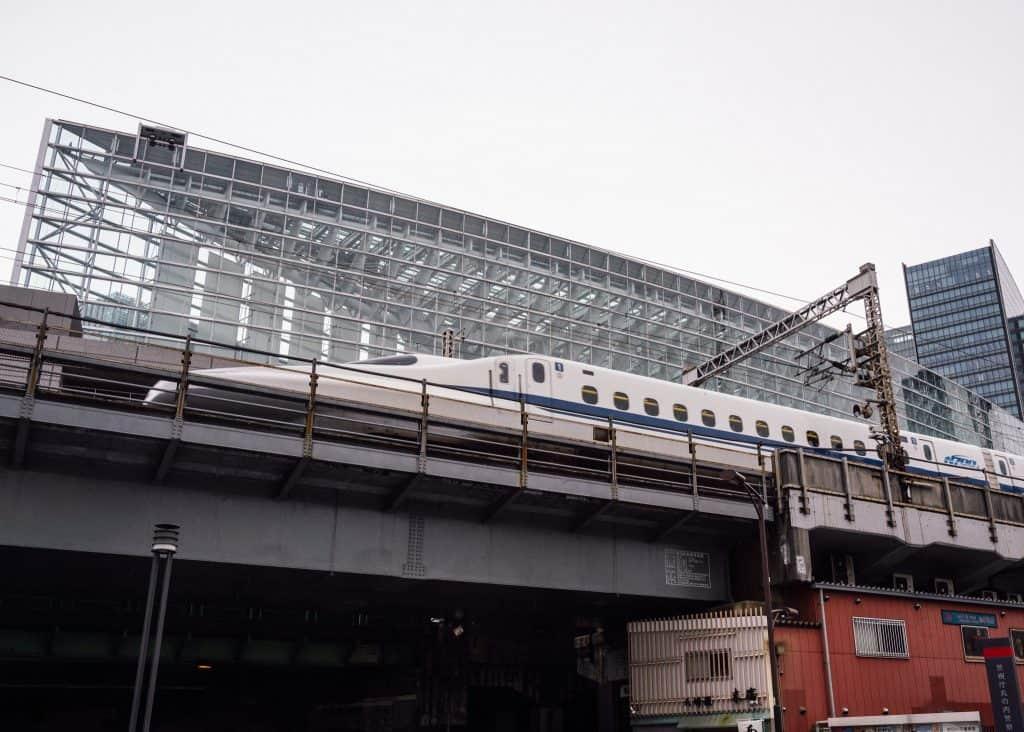Shinkansen passing in front of Tokyo International Forum building