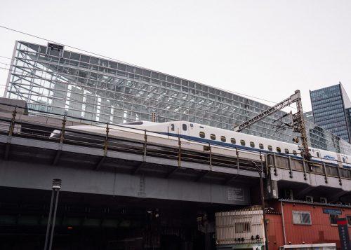 Shinkansen passing in front of Tokyo International Forum in Yurakucho.
