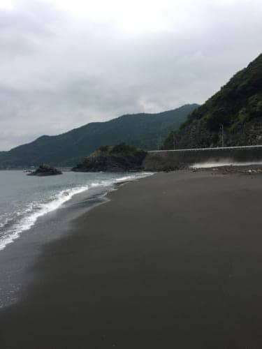 Motosaru Bay black sand beach