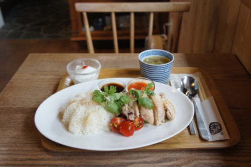 Hainan chicken at Coffee Sanpo, in a light wood decor