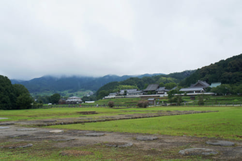 Tachibana-dera temple seen from the archaeological site of the ancient Kawahara-dera temple