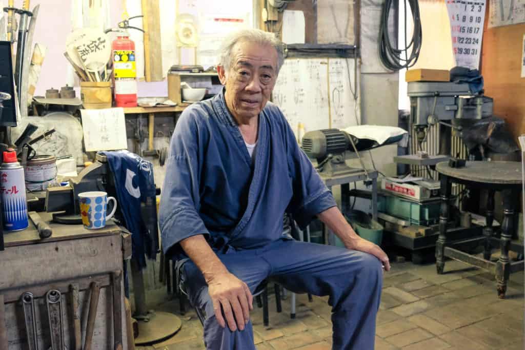 Mr. Matsunaga, a swordsmith in Arao, Kumamoto, in his studio