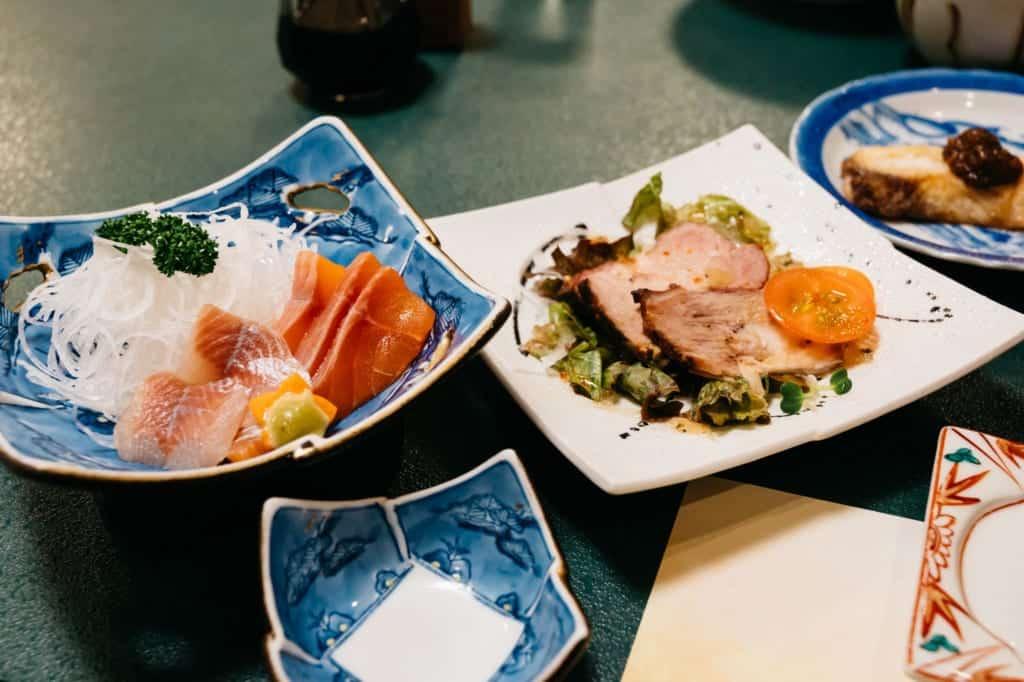 Sashimi and Miyuki pork at Kanoe Lodge