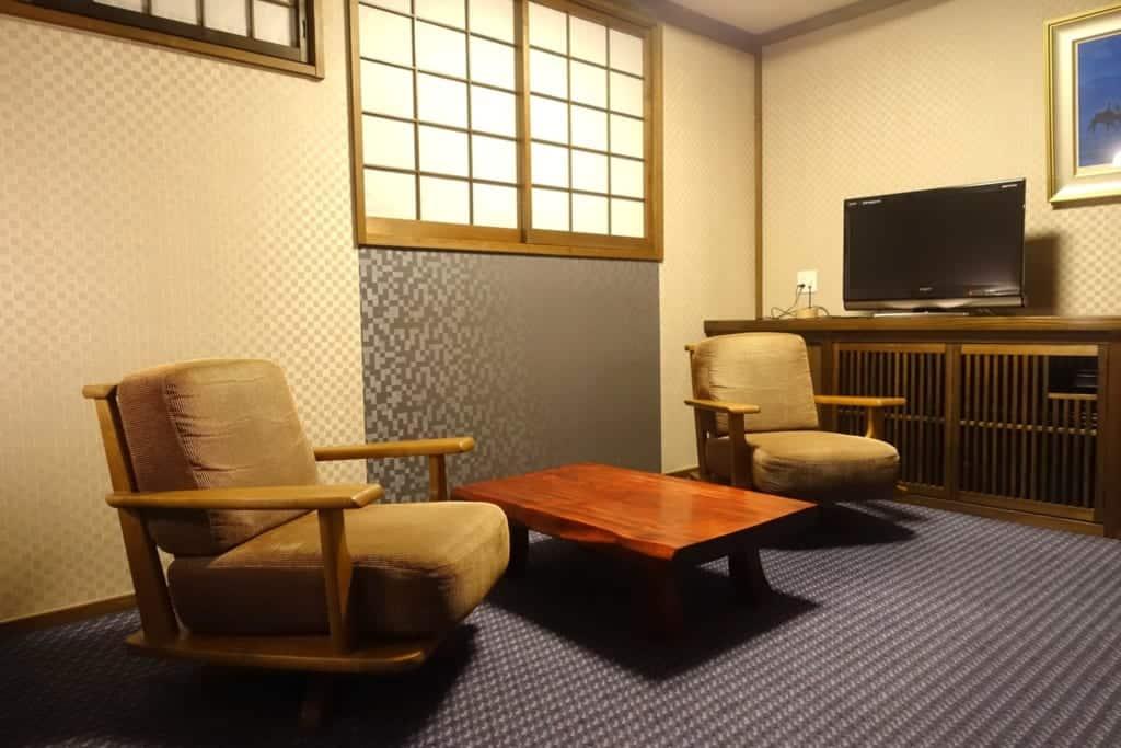 Reading corner of a room at the ryokan Yunoyado Motoyu club in Yuzawa, Japan