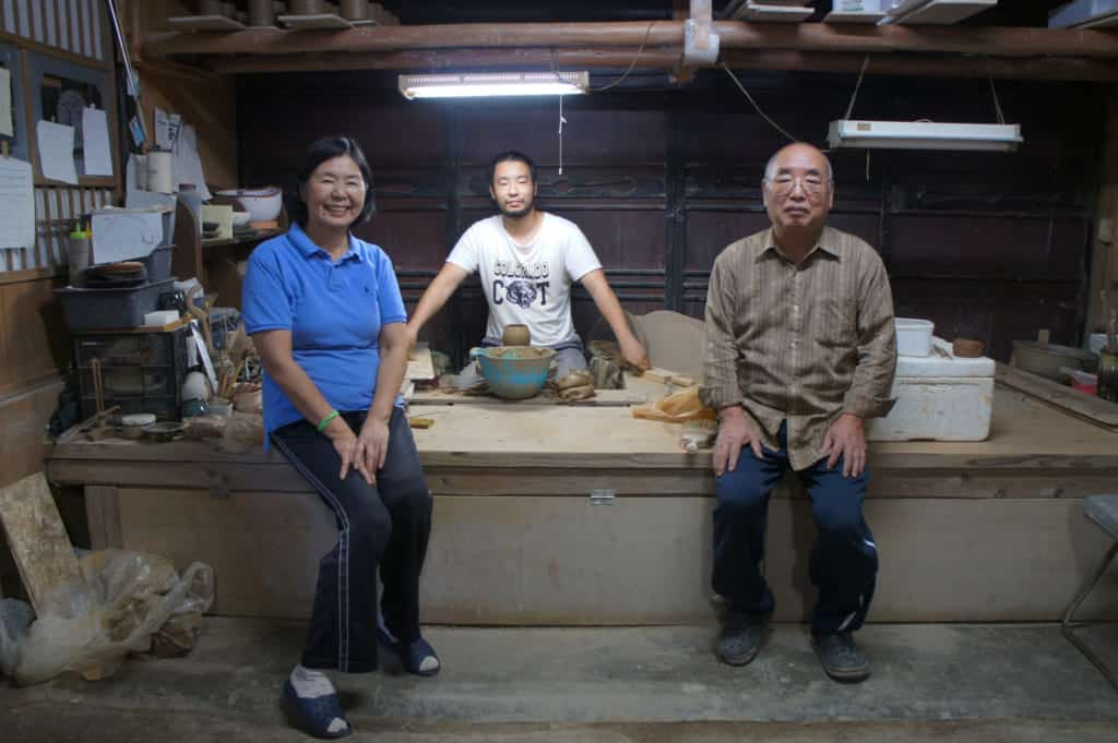 Yamaguchi family: parents and son, in their Shodai Yaki pottery workshop