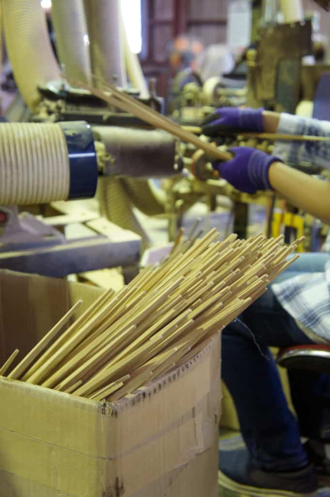 Worker, shaping chopsticks in Yamachiku factory