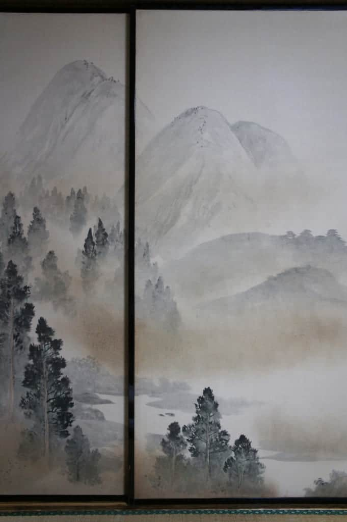 Traditional panel with a painting of mountain landscape