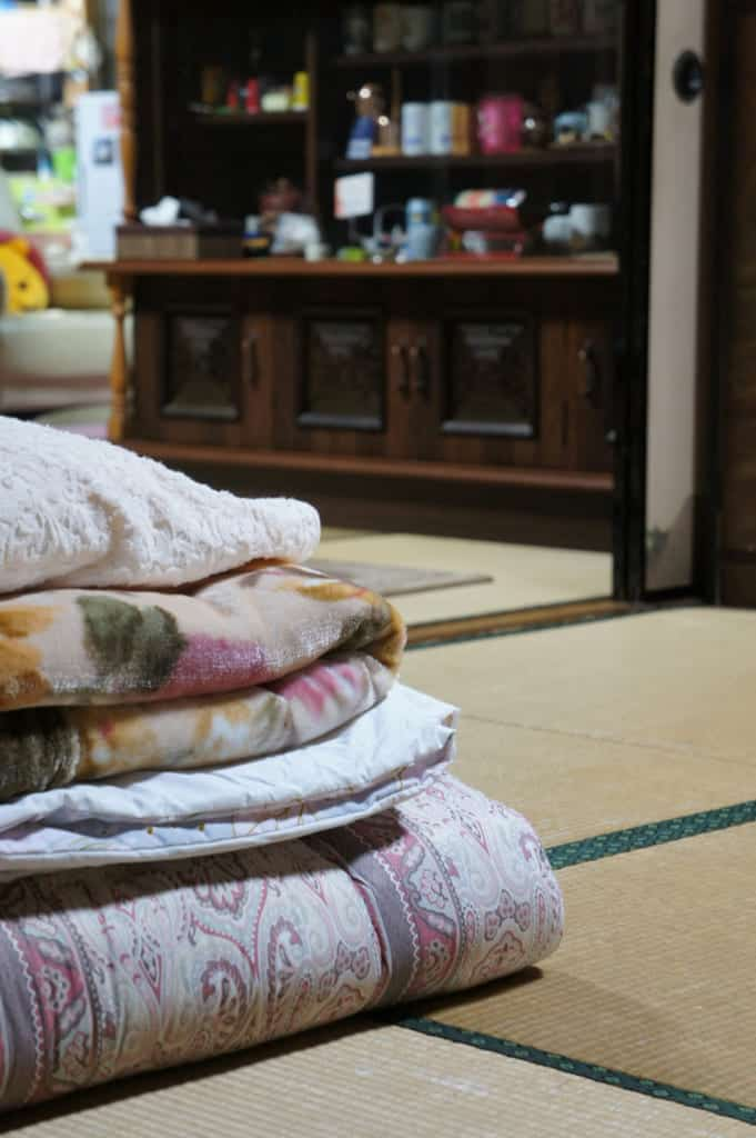 Futon and sheets prepared and folded in the tatami room