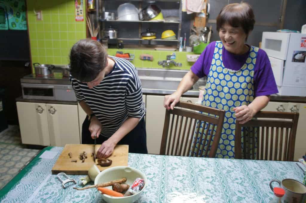 Mrs Yonemura teaching Clementine local receipts in her kitchen