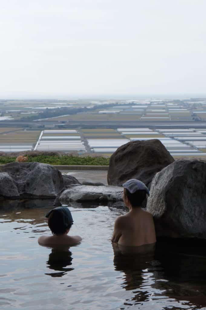 Two women, enjoying a bath at Kusamakura onsen Tensui