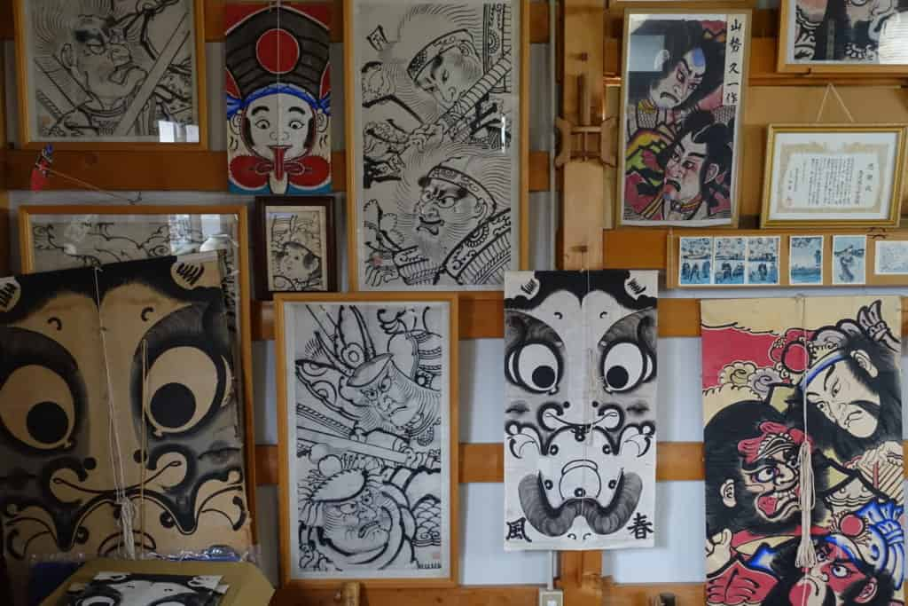 Managu kites hung on the wall of the Shunpu-Kan workshop in Yuzawa, Akita prefecture
