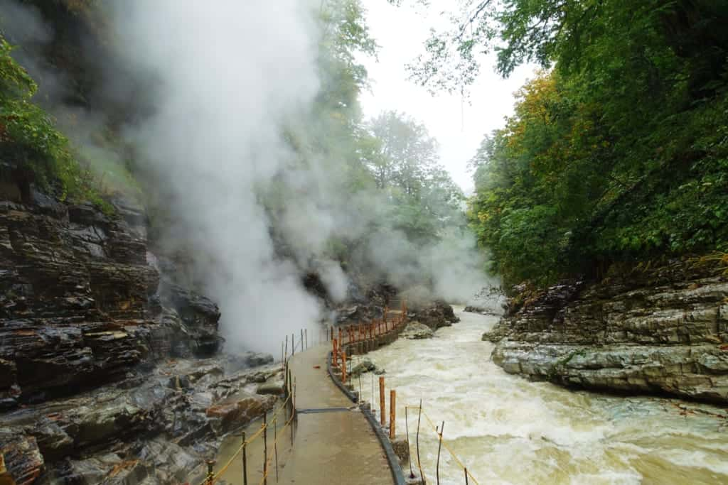 The hiking trail surrounded by dense clouds of steam