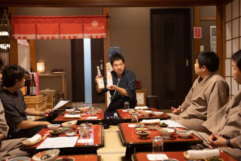 Mr. Takuya presenting sake in his inn.
