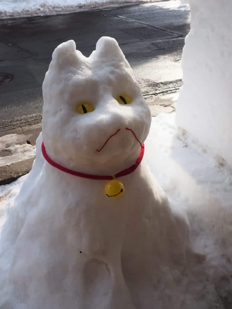 Dog carving in the snow during the Inukko Matsuri festival
