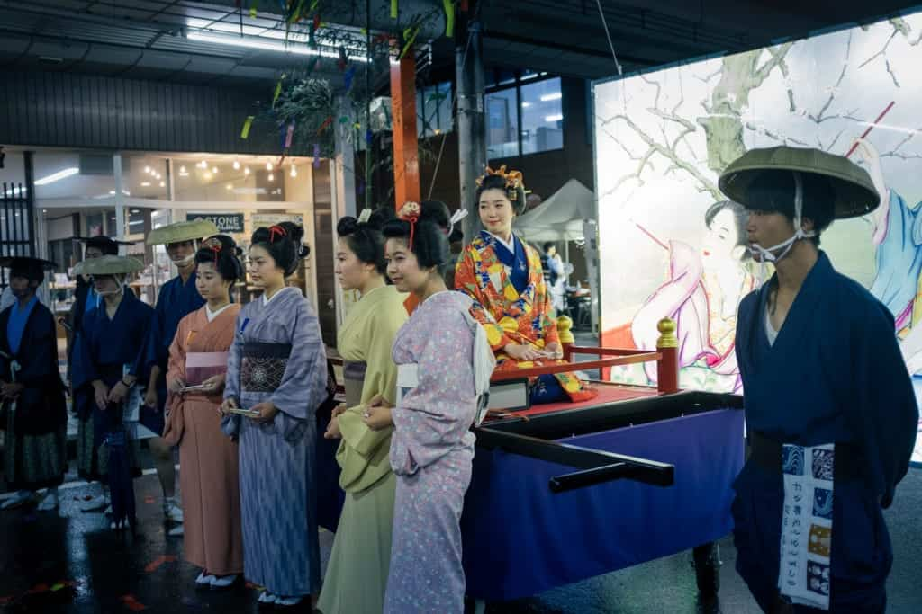 Women in kimono pose during the Tanabata festival parade in Yuzawa