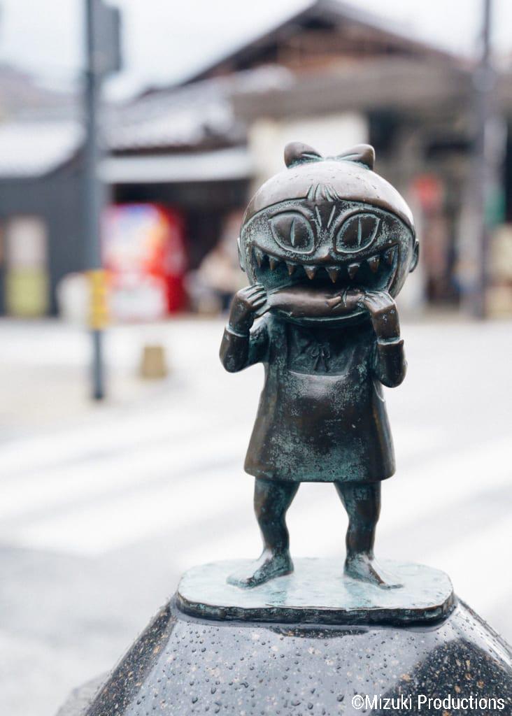 Bronze sculpture of Nekomusume on Mizuki Shigeru Road in Sakaiminato.