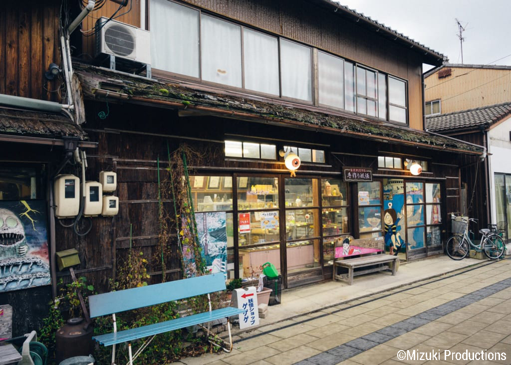 Shop on Mizuki Shigeru Road decorated with Kitaro images