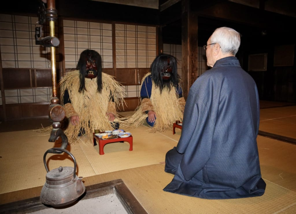 The reenactment of the Namahage scene from inside the Japanese house