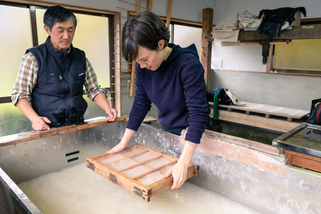 making japanese washi paper the traditional way in Kyoto, Japan