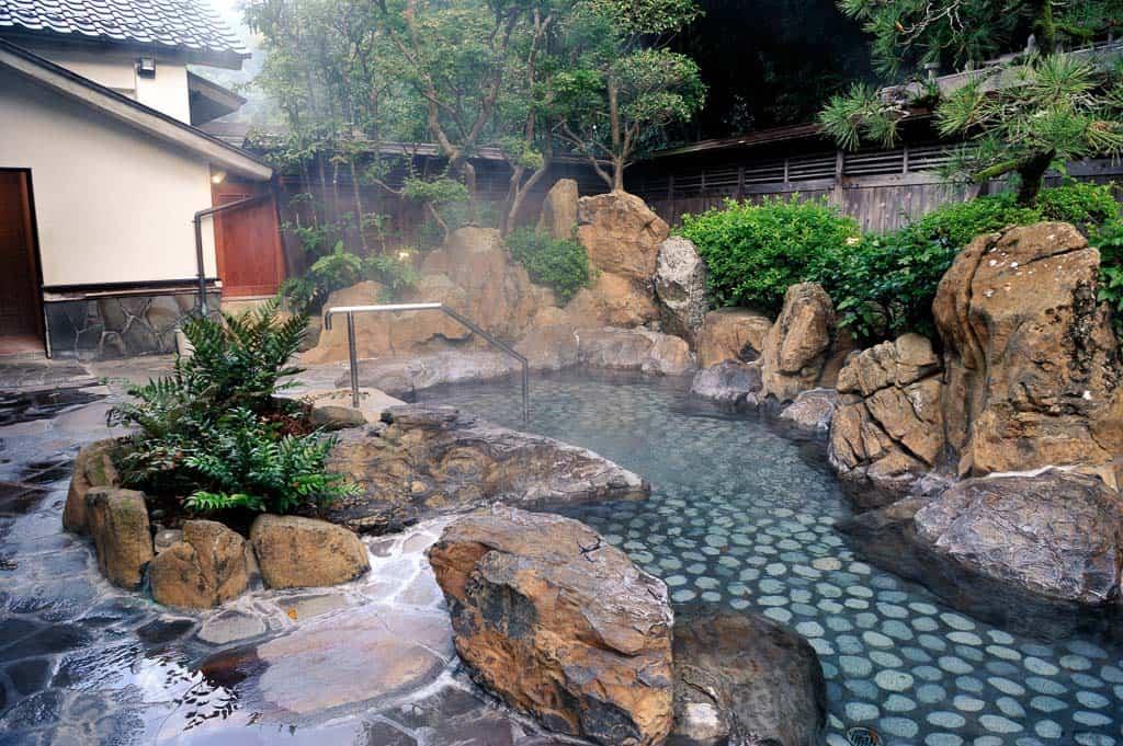 outdoor rotenburo bath at one of 7 public onsen hot springs in Kinosaki Onsen, Japan