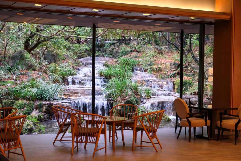 waterfall view from Japanese luxury hotel window in Japan