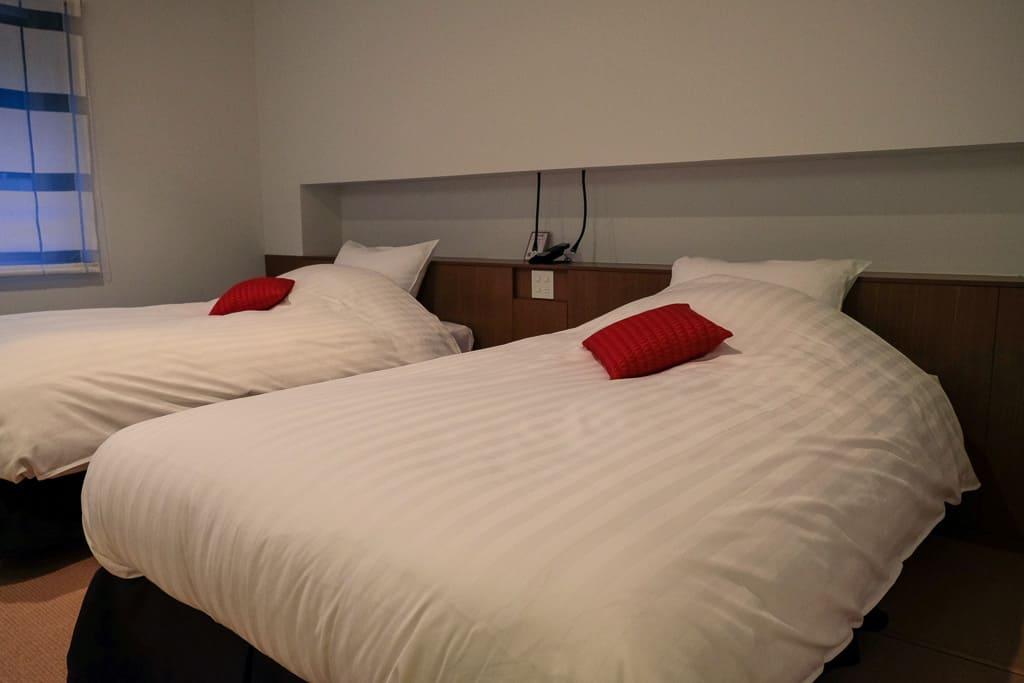 western style beds at Nishimuraya Hotel Shogetsutei, kinosaki onsen, Japan