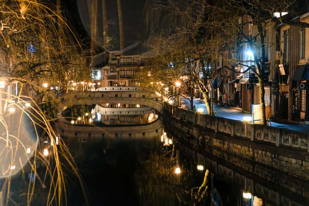 willow trees along Japanese canal in Kinosaki onsen, Japan