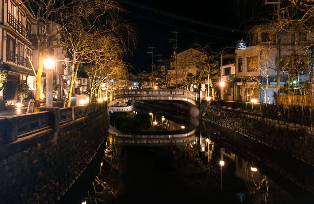 Traditional Japanese night time view of canals at Kinosaki Onsen town in Japan