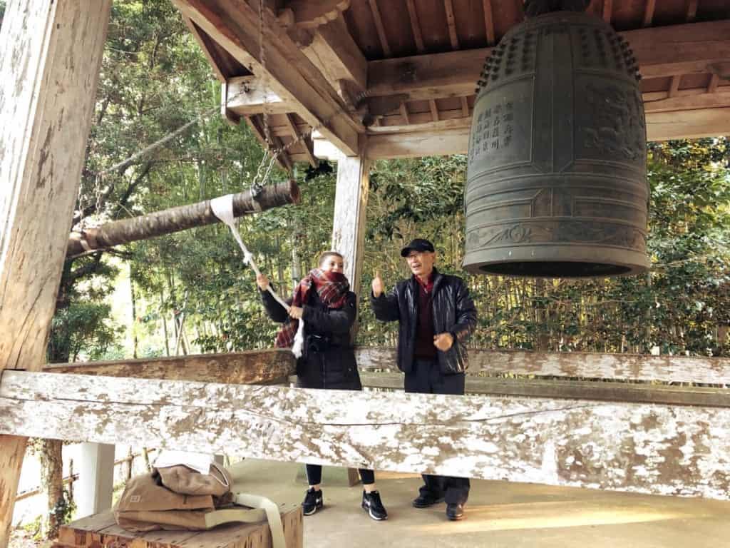Ringing a bell in Izumi, Kagoshima, Japan