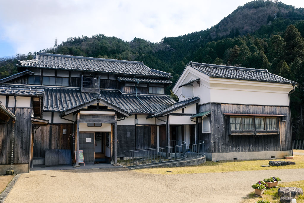 Traditional building and storehouse in Kuchiganaya Mining Town