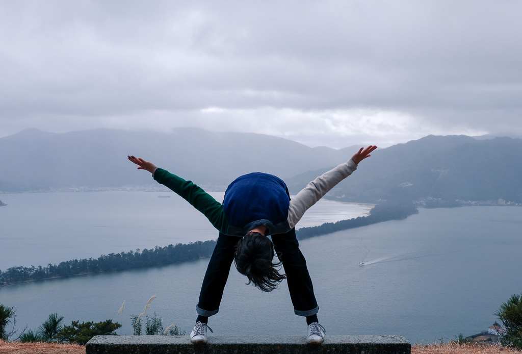 Participating in the upside down tradition of viewing Amanohashidate, one of the top three scenic sights in Japan