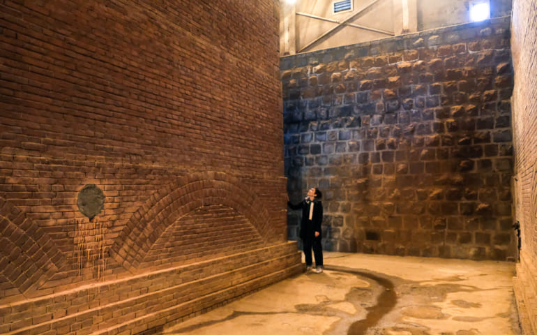 Mika standing in Maizuru's water filtration plant