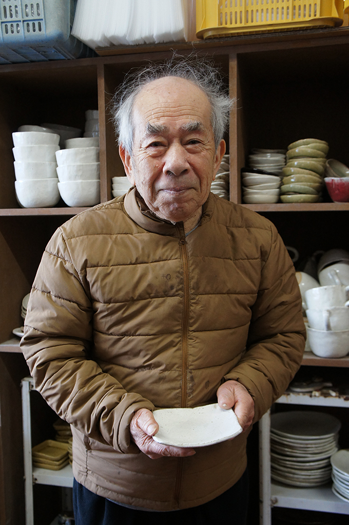 Resident holding a ceramic plate