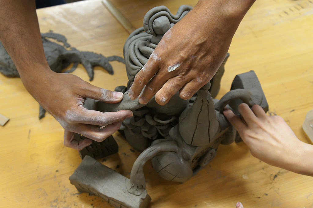 Moulding the clay