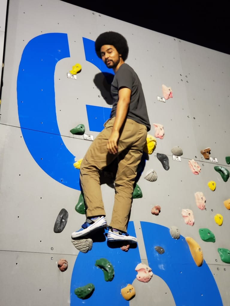 Using the climbing wall at Sporu