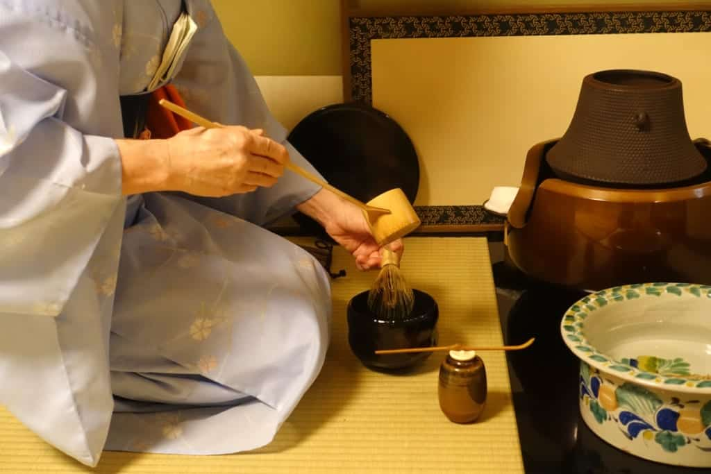 One of the meticulous steps to prepare the tea during a traditional Japanese tea ceremony