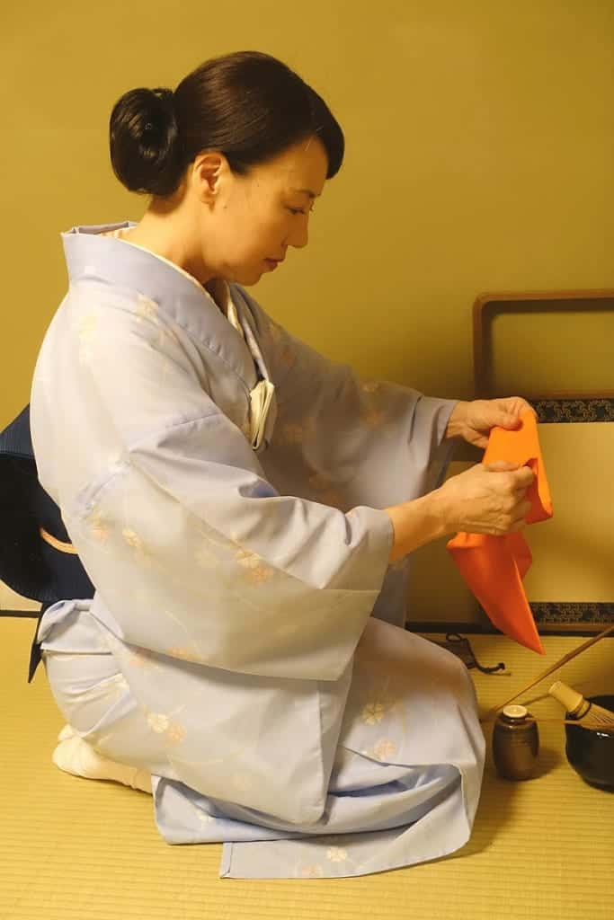 Mika repeats a succession of folds and unfolds of the fukusa during a Japanese tea ceremony workshop