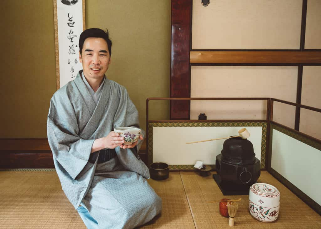 man practicing Japanese tea ceremony