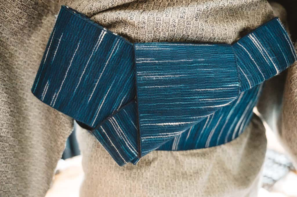 the bow tied on a men's obi
