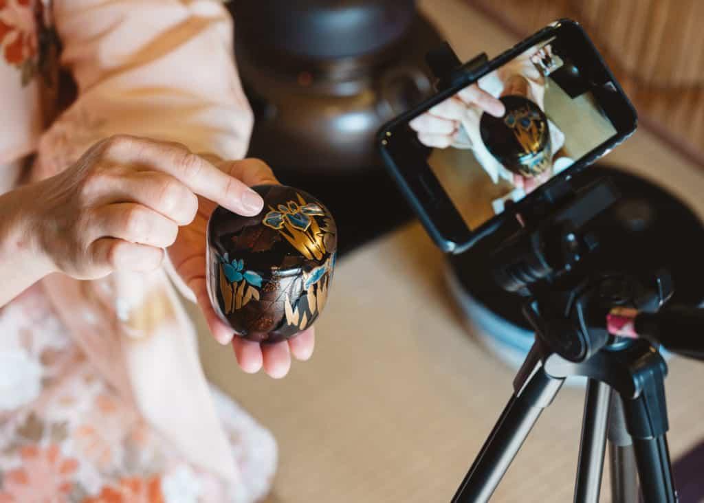 showing utensils during online tea ceremony