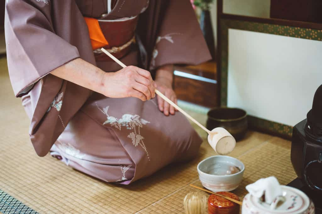 pouring hot water into the tea bowl during tea ceremony
