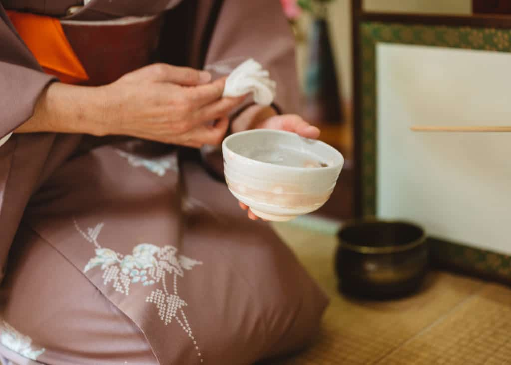 purifying the tea bowl for tea ceremony